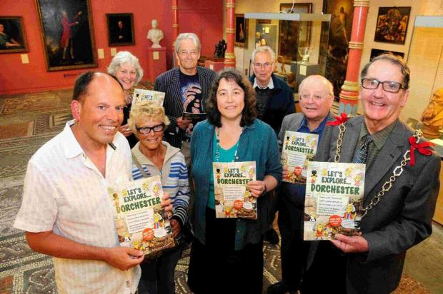 Dorset Echo: LET'S GO: At the launch, from left, Andy Canning, Mary Hawkins, Kate Hebditch, John Smith, Mayor Peter Mann, (Back) Tess James, Alistair Chisholm and Dave Roberts