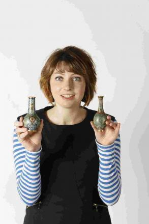 TINY MARVELS: Amy Brenan from Duke's with a pair of miniature vases that sold for a combined £45,000