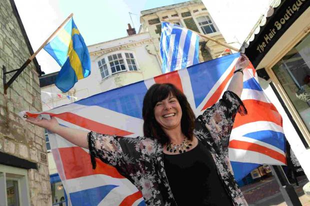 COME ON DOWN:  Suzanne Fry with some of the flags in St Alban Street, Weymouth