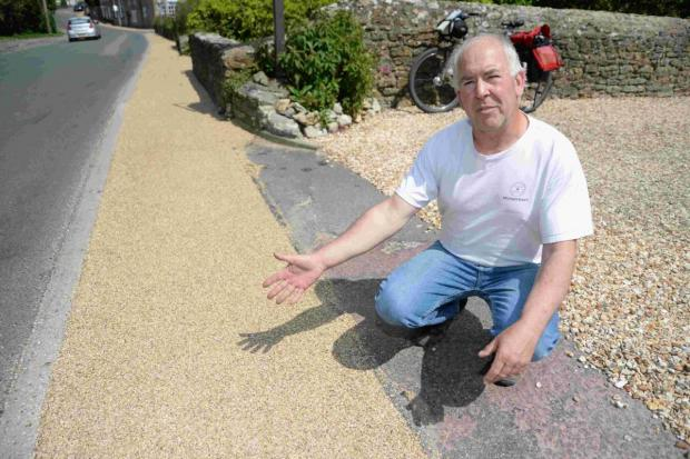 WATER MESS: Robin Fedden disgusted at work on new pavement, which has covered up his water meter covers in Burton Bradstock