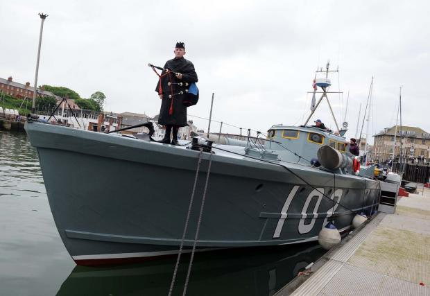 Dorset Echo: VOYAGE: Piper Karl Wainwright aboard MTB-102 in Weymouth Harbour. Picture: FINNBARR WEBSTER