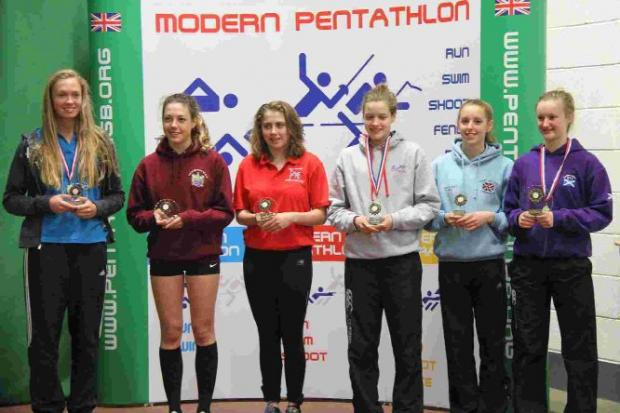 ON THE PODIUM: Mollie Hansford, second right, and Rebecca Bowles, third right, representing Dorset Pentathletes