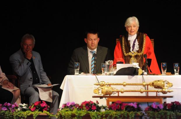 SPEECH: Ray Banham (far left) looks on as new Mayor Kate Wheller makes her speech.  Picture: Finnbar Webster