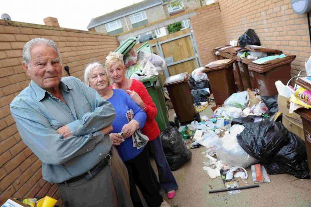 Dorset Echo: HEALTH HAZARD: Cyrill Gill, Rose Malcolm and Rosalind MacGregor in the bin store