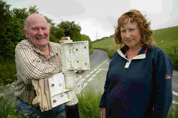 NATIONAL HERITAGE: Peter Jones and Sue Mitchell with the road sign in Coombe Valley Road, Preston