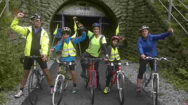 Youngsters East and Phulmaya Bhusal setting off on their charity bike ride with mum Natasha, centre, and their uncle Nick  and his wife Clare