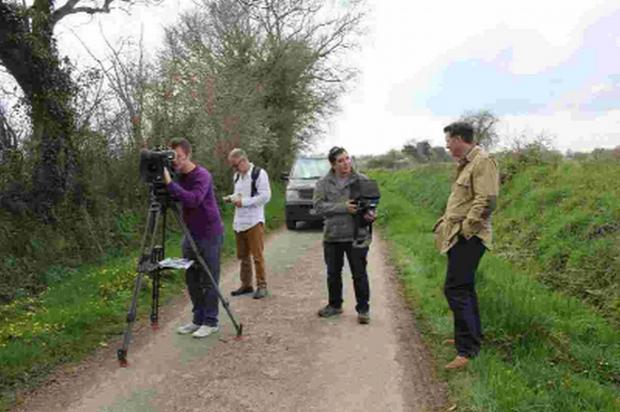 ACTION: Shooting the documentary on location in Normandy. From left, director of photography Jon Wood, Keith Branch, sound, producer Aaron Young and presenter James Holland