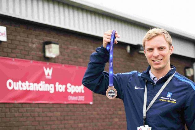NATIONAL PRIDE: Weymouth College sports lecturer Tom Priest with his bronze medal