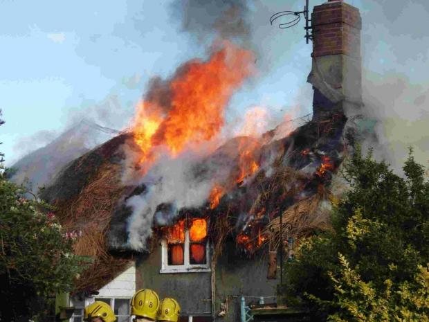 DANGEROUS: The fire at the historic Hurst Green Cottage, Moreton
