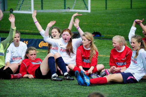 SAINTS ALIVE: All Saints School pupils cheering on their team-mates