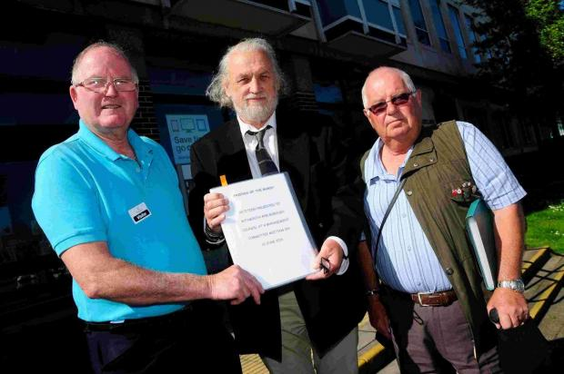 HANDOVER: David Nelmes, left, and John Bowditch, right, present the petition to Cllr Mike Byatt.   Picture: GRAHAM HUNT