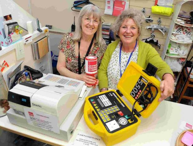 HELPING HAND: Leonard Cheshire  charity shop  manager Anne Slattery, left, and assistant Lyn Woodhall