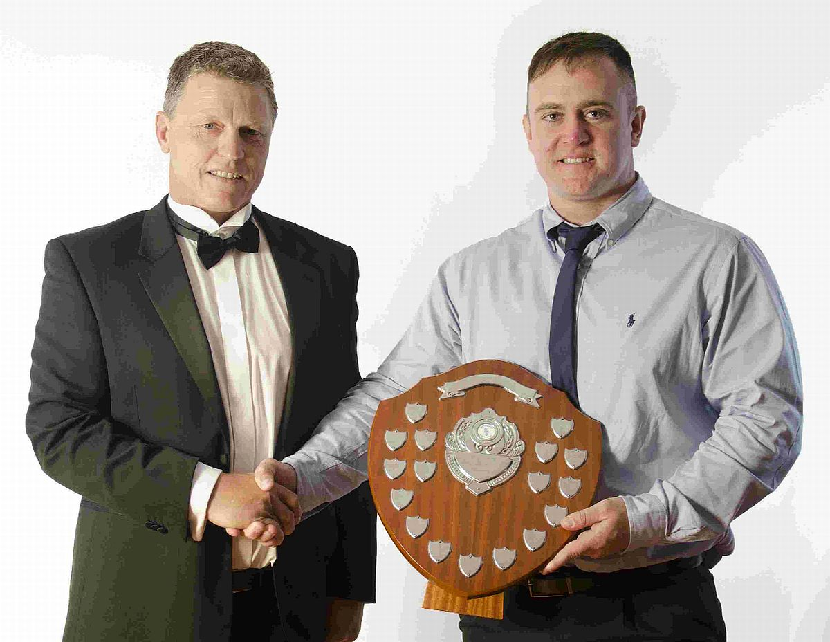 DOUBLE AWARD: Club captain Kevin Leatham presents the award for most tries in a season to Sean Murphy, who als