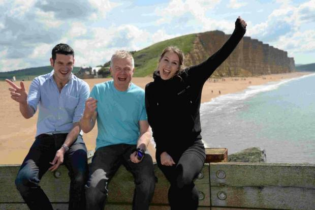 HOORAY: West Bay traders celebrate the return of Broadchurch, from left, Tim Attrill, Steve Tucker and Becky Black