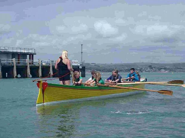 IN RHYTHM: Weymouth Cadets enjoy gig rowing