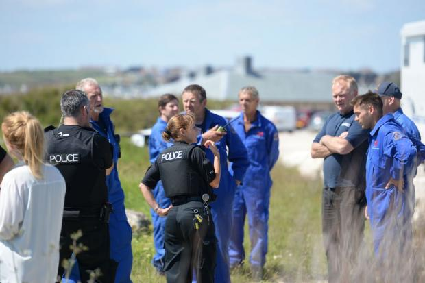 SEARCH: Police and coastguard teams at the scene.  Picture: JOHN GURD