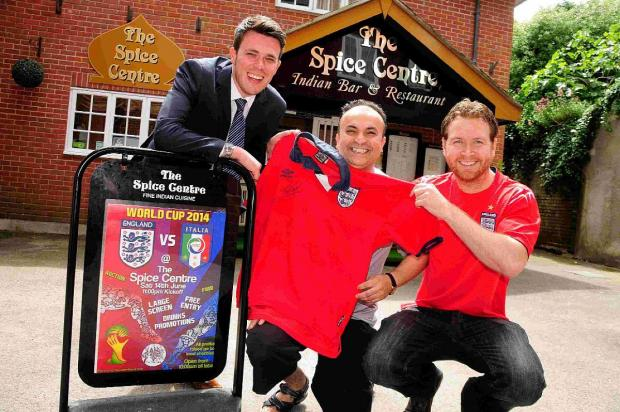 FOOTBALL FEVER: Nick Grassby, Abu Baker and Simon Slade with the signed shirt up for grabs