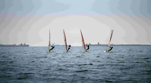 SEA FUN: Windsurfers looking to crest the next wave