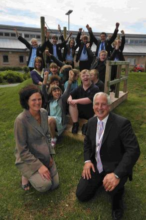 HOORAY! Celebrating becoming a Trust school, Wey Valley head Phil Thomas and Wyvern head Sue Hoxey with pupils