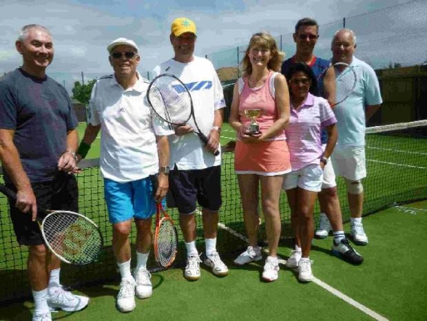 WINTER WONDERS: Team captain Glenda Fraser shows off the Yeovil & District Winter League trophy to fellow members of Melcombe Regis Lawn Tennis Club