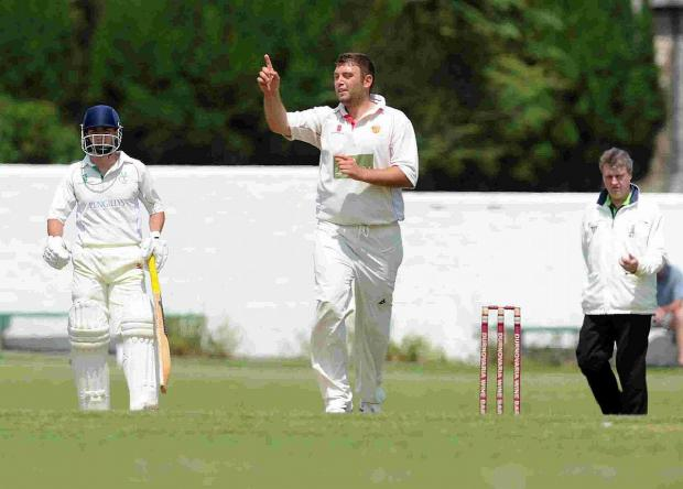 THREE WICKETS: Dorchester skipper Dan Belt