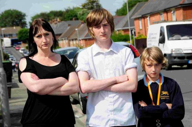 Dorset Echo: NOT HAPPY: Kellie Shapley with her sons Lee and Taryn who had their bikes stolen