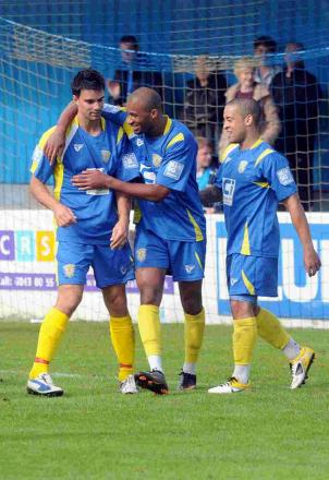 EYES ON PROMOTION: Tim Sills, left, pictured playing for Basingstoke