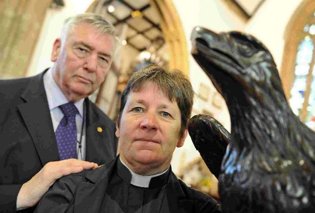 'POINTLESS ACT' Vicar Vicky Thurtell and church warden Brian Hellin with the Eagle lectern vandalised at St Peter's Church in Dorchester