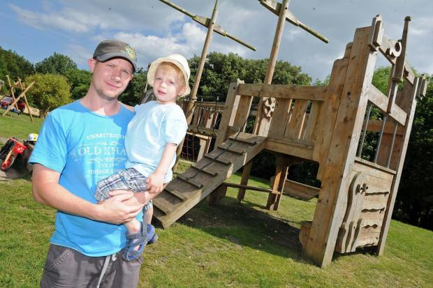 Dorset Echo: Nathan Hawker and his son Austin at the damaged play area