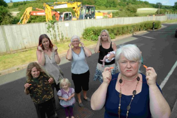 EARACHE: Kathy Ridley, right, with from left, Hannah Stone, Sue White and Maria Stone near the rail work at Maiden Newton