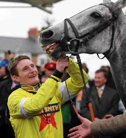 DARYL'S DELIGHT: Daryl Jacob celebrates after winning the Grand National in 2012 on Neptune Collonges