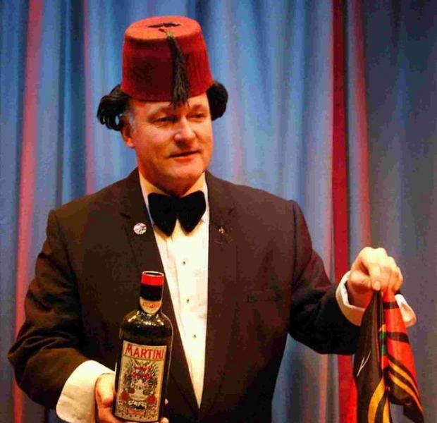 GLASS, BOTTLE, BOTTLE, GLASS: Clive Greenaway as Tommy Cooper
