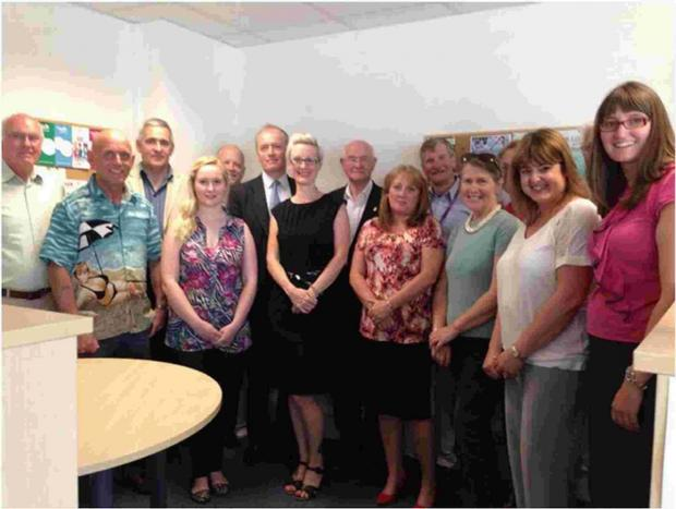 Dorset Echo: SUPPORT:  Volunteers with chief executive Mark Castle and senior manager Kerry McGeachy