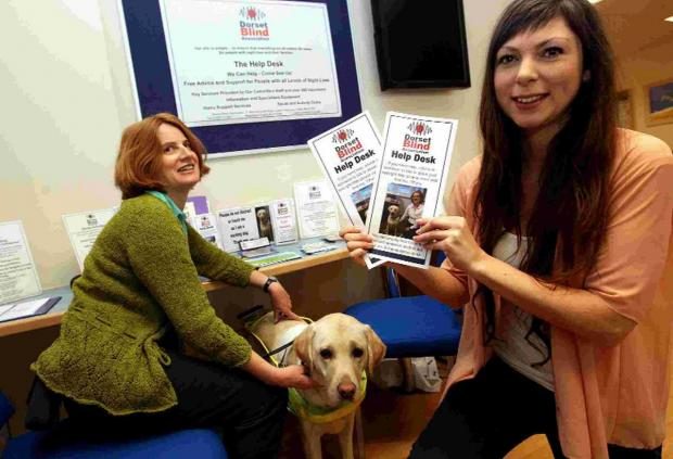 Dorset Echo: blind support: Eye Unit Support Officer Tiffany Deacon with her guide dog and Jaya Da Costa from th
