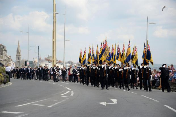 Veterans march through Weymouth during armed forces weekend