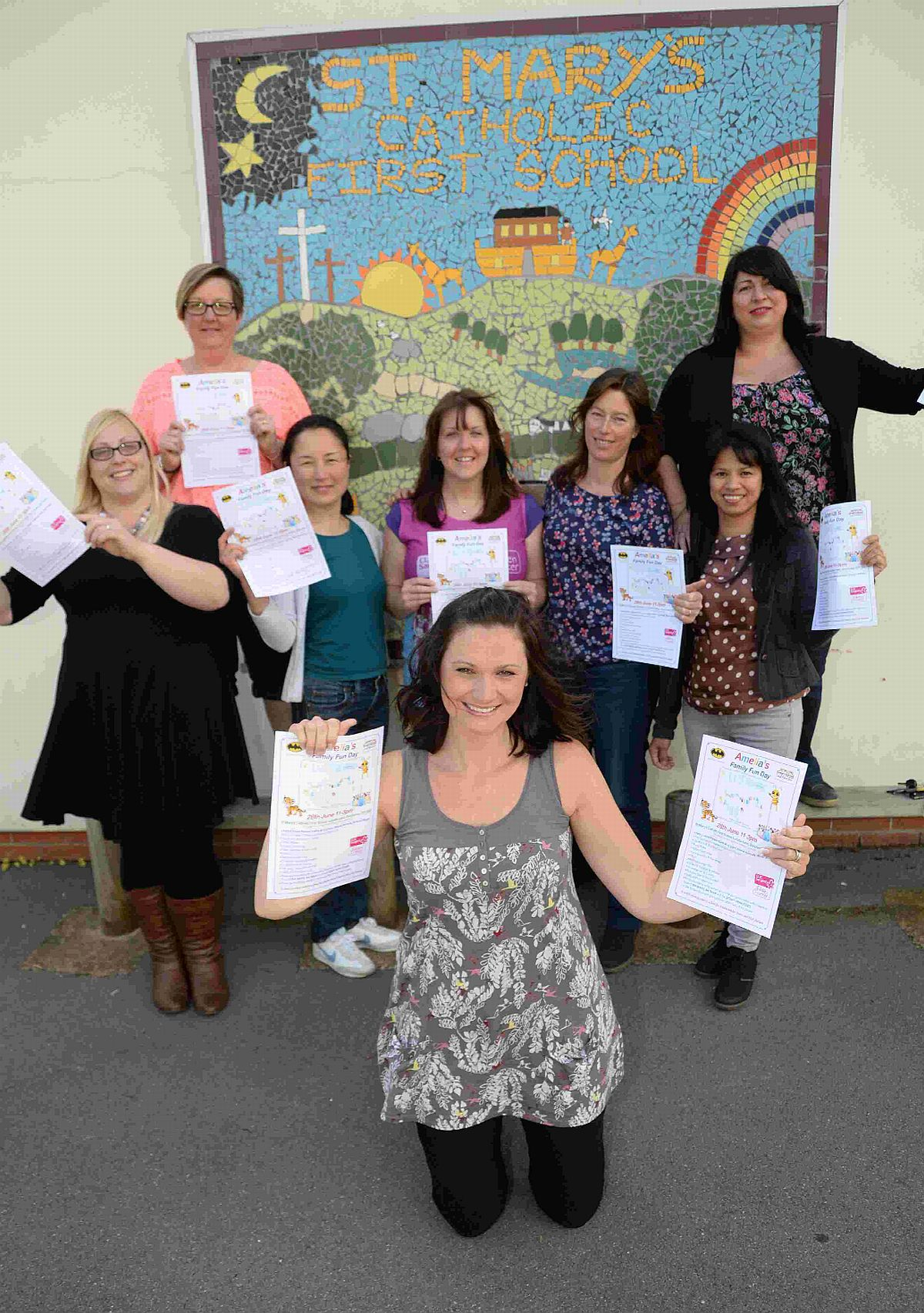 PULLING TOGETHER: Holly Parkin with friends who are organising a family fun day