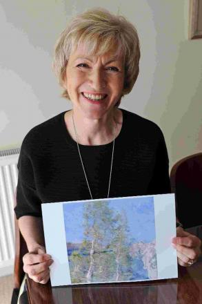 SHOWING HER WORK: Claire Onions holds her award-winning picture
