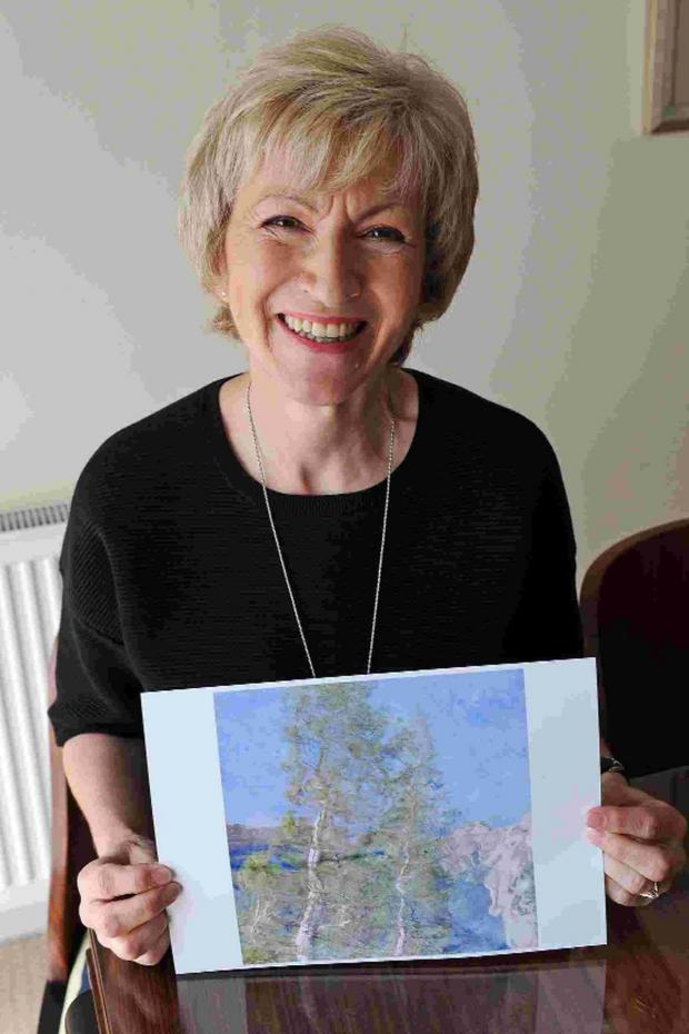 Dorset Echo: SHOWING HER WORK: Claire Onions holds her award-winning picture