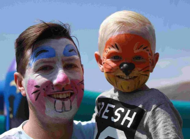 FUN TIME: Adam Anstey with son Harley at the Family Fun Day
