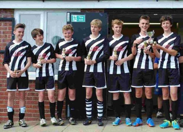 Dorset Echo: OVERALL WINNERS: The Tigers One team show off their trophies after winning the final at Lytchett