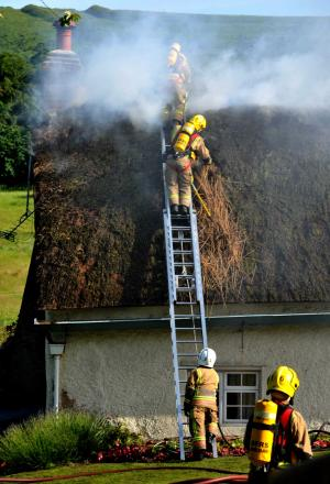 Firefighters tackle the blaze in East Lulworth. Photo; Dorset Media Service