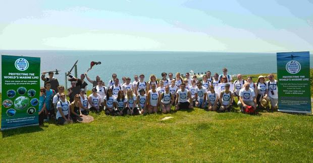 ON THE MARCH: Staff from various Sea Life Centres around the UK take part in a coastal walk for the Sealife Trust