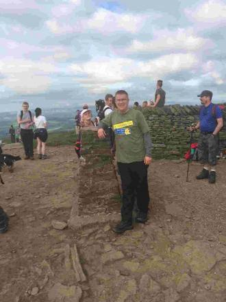 HIGH TIME: Martyn Price at the summit of Pen-y-Ghent on his Yorkshire Three Peaks challenge