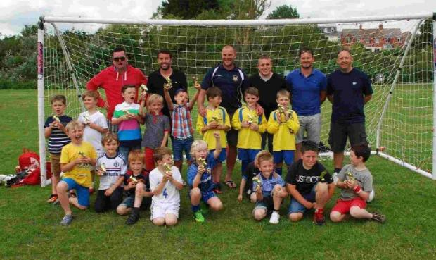 PROUD: Coaches and players from the Weymouth Cougars Under-7s set up