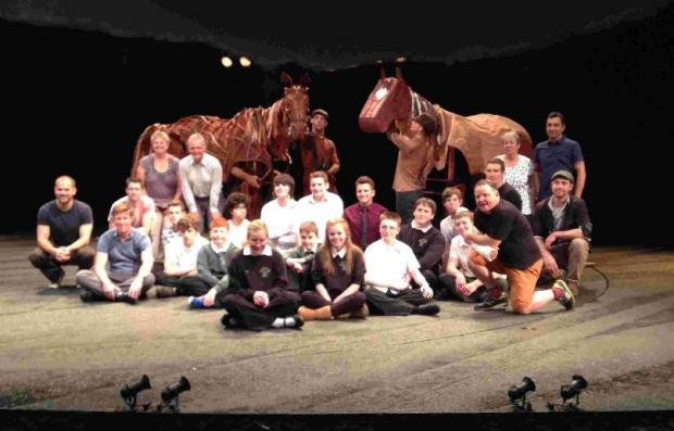 HORSES FOR COURSES: Carl Woodward with pupils and the War Horse puppets