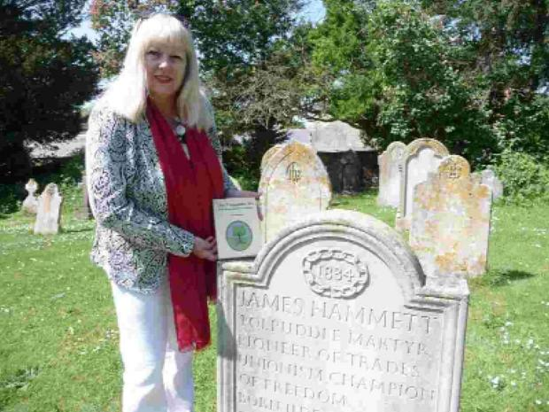 BOOK: Sally McMahon with her book The Tolpuddle Six, the Hammett relative at the grave of Tolpuddle Martyr James Hammett