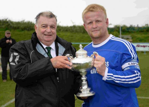 HAPPY DAYS: Portland's Lewis Whyton receives the league trophy from Mike Mock last season