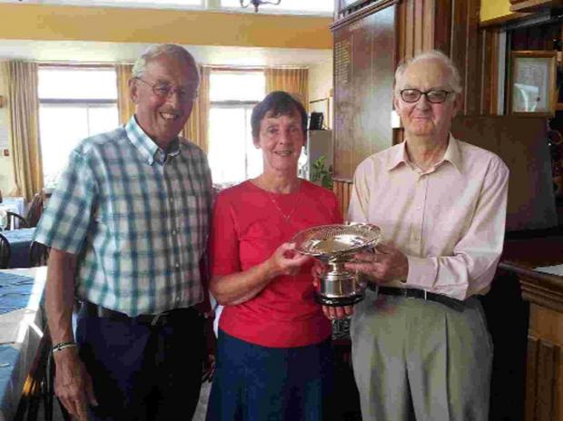 WINNERS: Came Down Golf Club president Charles Foster presents Eileen McBride and Ian Brittain with the Norah Walne Trophy