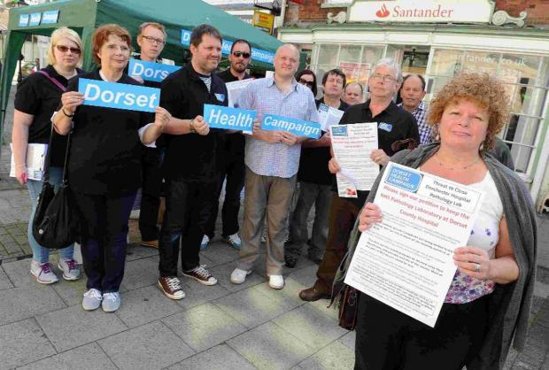PROTEST: Campaigners urge people to sign a petition petition to keep DCH's pathology department publicly owned. County Councillor Ros Kayes is on the right