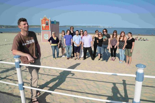 BIG PLANS: Baron Miles and supporters on Weymouth beach to promote new website